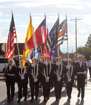 Alamogordo AFJROTC march in the 9/11 Memorial Parade Tuesday.