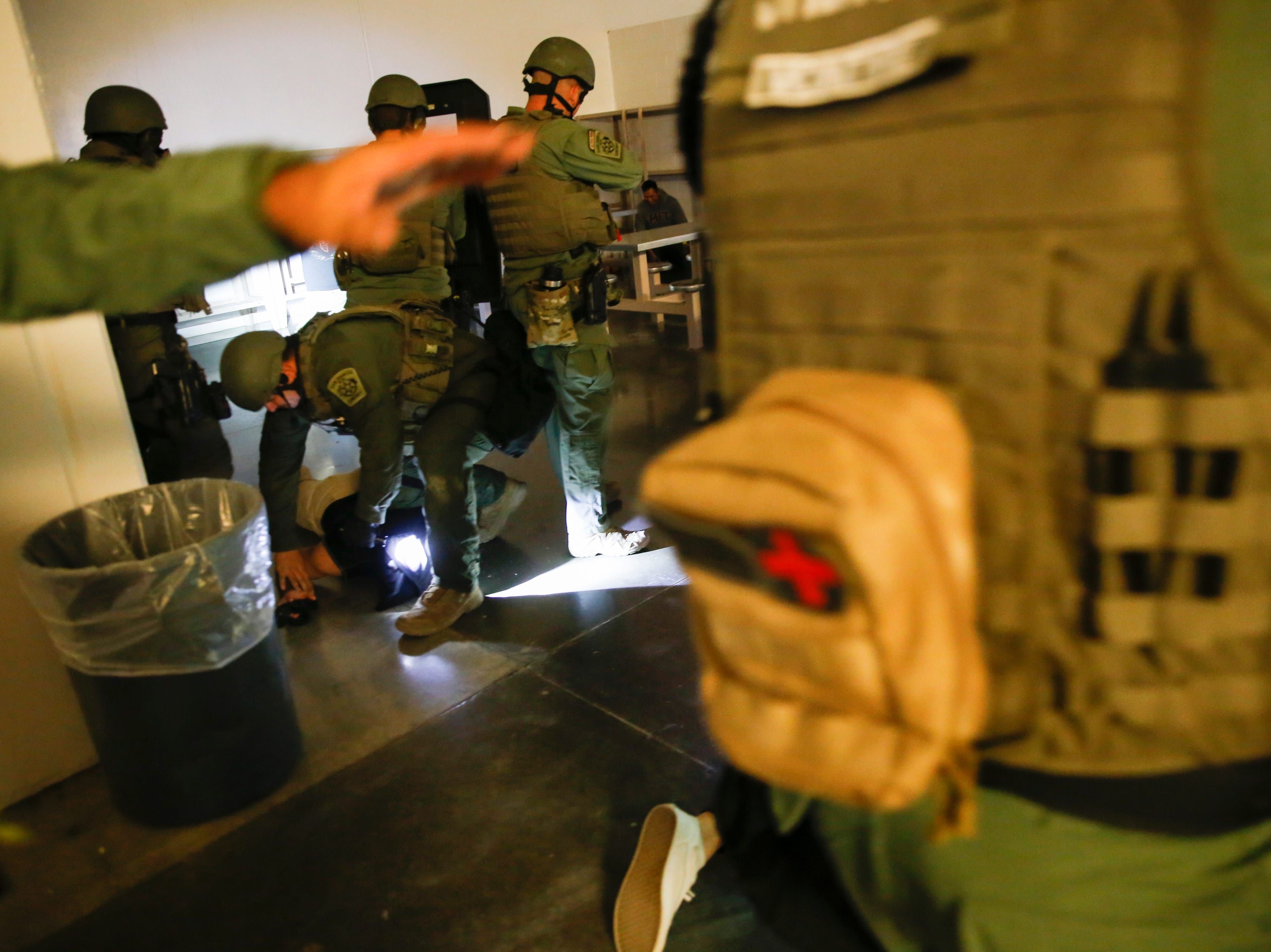 Members of the San Juan County Sheriff's Office SWAT team attempt to gain control a simulated riot, Wednesday, Sept. 12, 2018 inside the San Juan County Detention Center in Farmington.