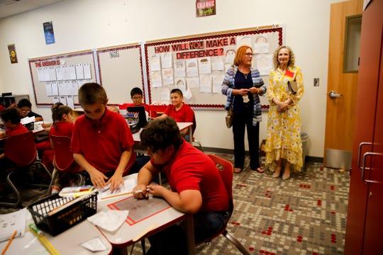 McCormick Elementary School Principal Lyn White, left, provides a tour of her newly renovated school to Farmington school board Secretary Robyn Hoffman Wednesday in Farmington.