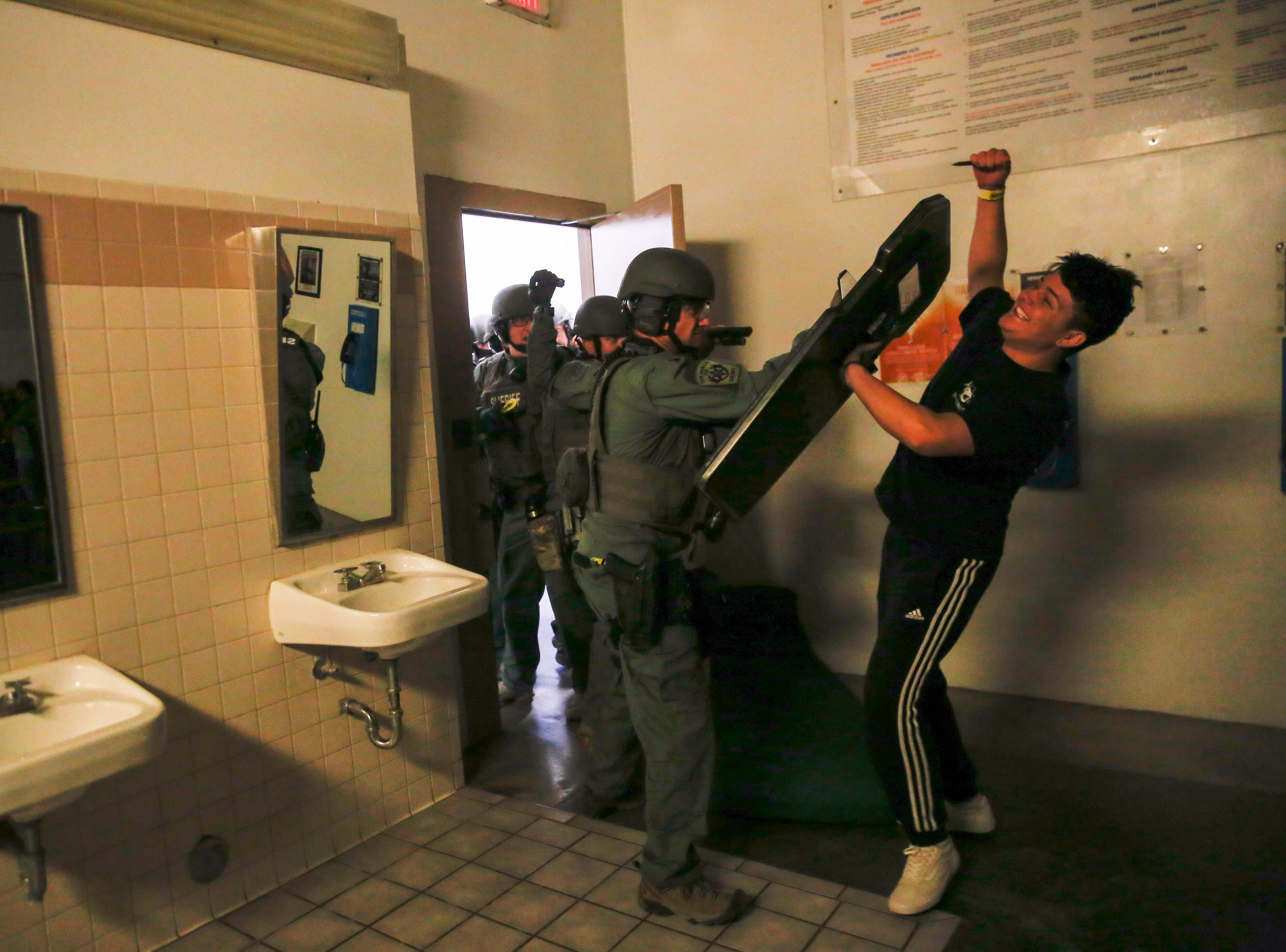 Members of the San Juan County Sheriff's Office SWAT team breach the a door where a simulated prison riot is taking place, Wednesday, Sept. 12, 2018 at the San Juan County Detention Center in Farmington.