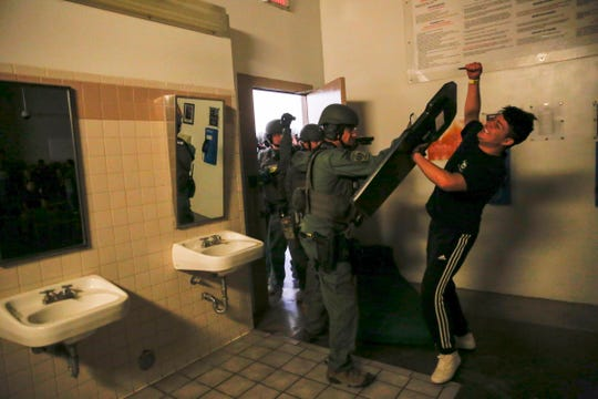 Members of the San Juan County Sheriff's Office SWAT team breach a door during a simulated prison riot Wednesday at the San Juan County Detention Center in Farmington.
