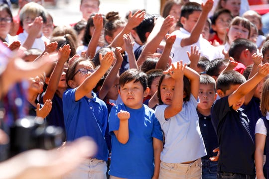 McCormick Elementary School students recite the New Mexico pledge Wednesday during a ribbon-cutting ceremony at their newly renovated school in Farmington.