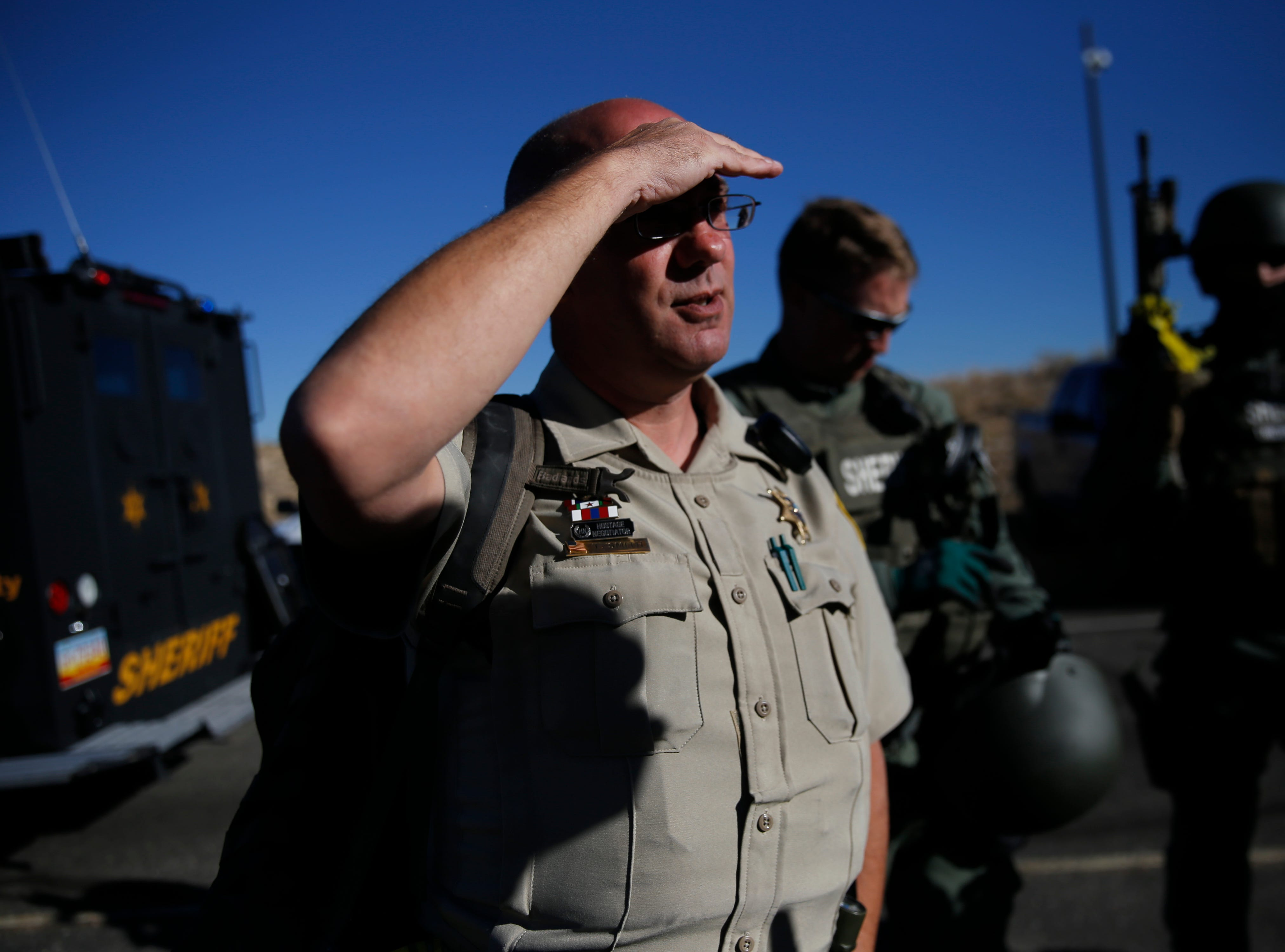 San Juan County Sheriff's Office Crisis Negotiator Cpl. Tim Smith gathers information on a simulated prison riot, Wednesday, Sept. 12, 2018 at the San Juan County Detention Center in Farmington.