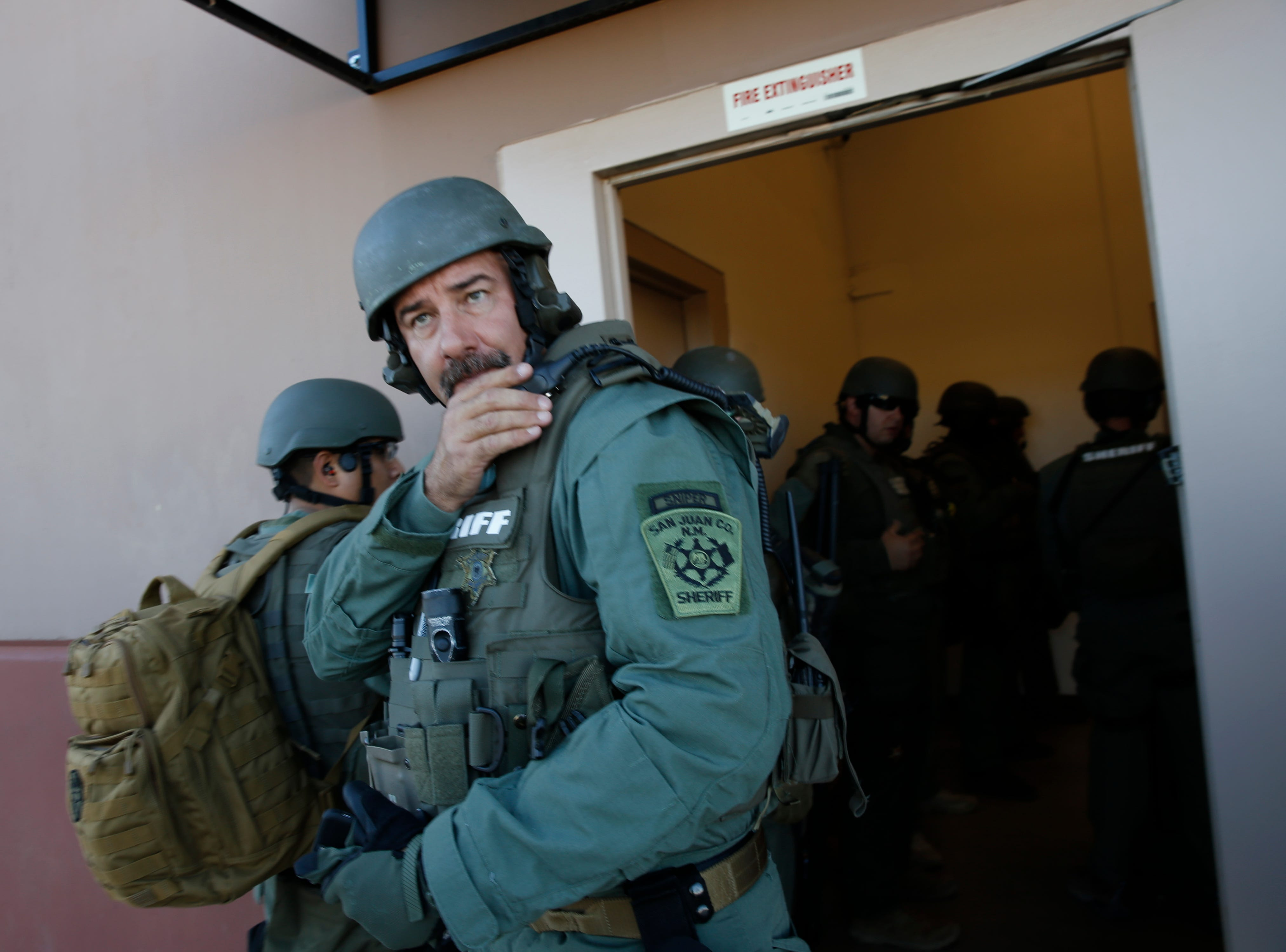 San Juan County Sheriff's Office SWAT team leader Sgt. Dave McCall collects information on a simulated prison riot before his team enters the San Juan County Detention Center, Wednesday, Sept. 12, 2018 in Farmington.