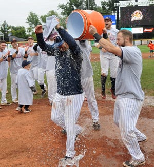 Birmingham-Bloomfield manager Chris Newell, who has led the Beavers to two titles during the USPBL's three-year existence, is doused with water by his team after his most recent victory.