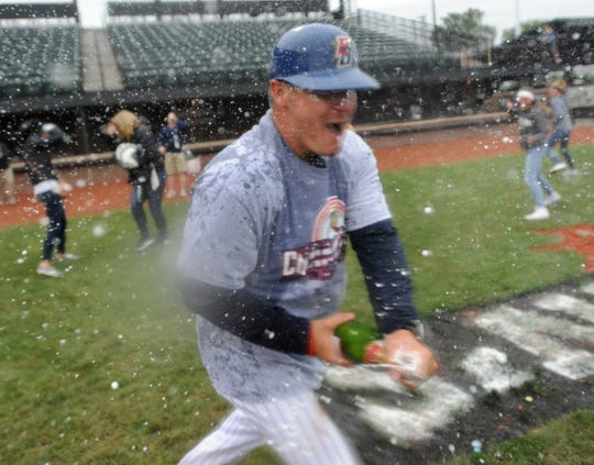 Birmingham-Bloomfield manager Chris Newell celebrates his team's victory over the Eastside Diamond Hoppers in the USPBL championship game.