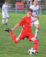 Canton's Nick Rockafellow (3) takes aim chased by Salem's Aidan Walesch.