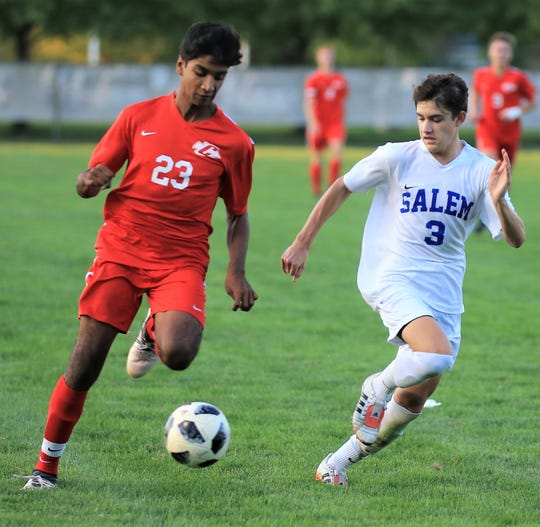 Canton's Srikar Komanduri (23), chased by Salem's Nolan Chaput (3), had a goal and assist in a 3-2 win.