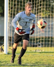 Canton goalkeeeper Ian Nielsen starts out on the  attack in a 3-2 KLAA West win over rival Salem.