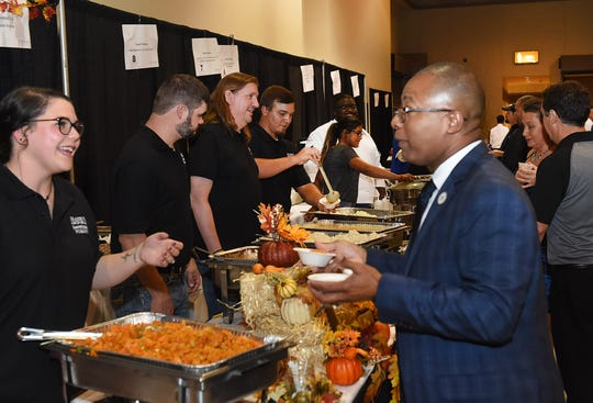St. Landry Parish School Board Superintendent Patrick Jenkins samples a dish from Frank's Po Boys at Monday night's Soiree Royale hosted by the St. Landry Chamber of Commerce.