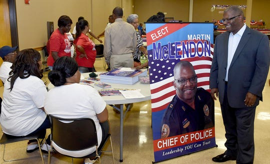 Martin . McLendon, candidate for Opelousas Police Chief talks with voters at Monday night's candidates meet and greet hosted by the St. Landry Federation of Democratic Women.