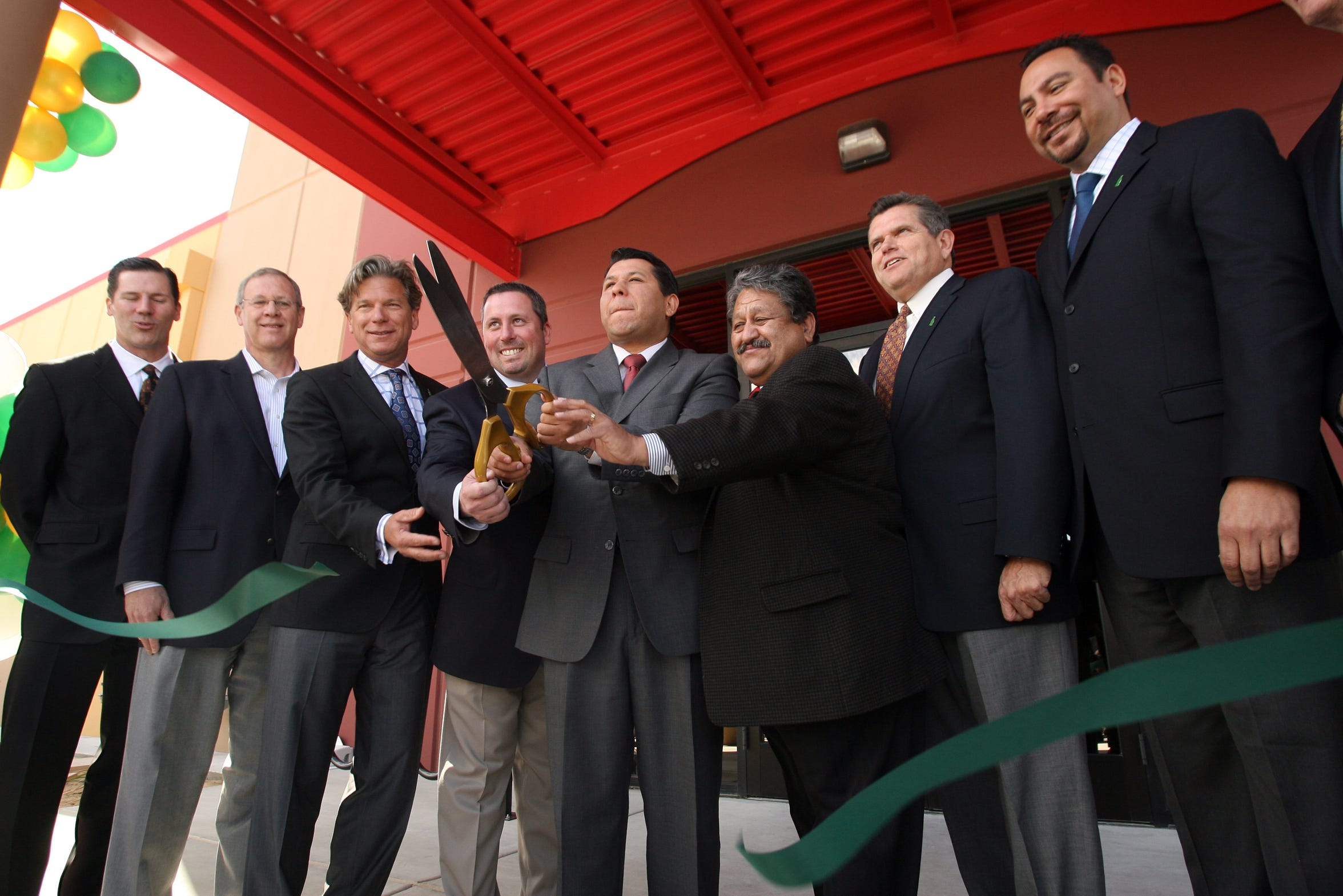 Then-Coachella Mayor Eduardo Garcia (center) and other officials at the opening of the Coca-Cola Bottling Company of Southern California's new Sales Center in Coachella, Calif. on Wednesday, April 21, 2010.