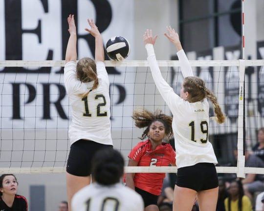 Maribel Wright spikes the ball right through Xavier Prep. The Xavier Prep varsity volleyball team won Tuesday's home conference match against Palm Springs (CA) by a score of 3-1.