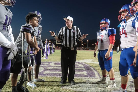 Referee Mike Sellin oversees the coin-toss for the Indio Sahdow Hills football game on Friday, September 7, 2018.