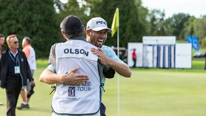 Catholic High grad Blake Olson (hat) celebrates with his caddie after winning Sunday's PGA Tour Canada-Mackenzie Tour event in Montreal