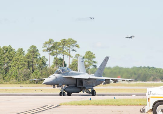 An F/A-18 Super Hornet aircraft from Naval Air Station Oceana lands at Naval Air Station Pensacola on Sept. 12, 2018.