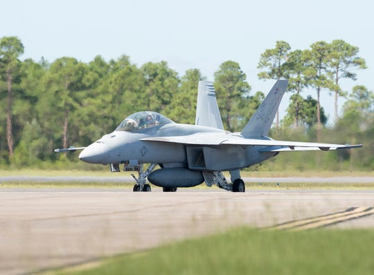 An F/A-18 Super Hornet from Naval Air Station Oceana in Virginia Beach, Va., taxis after landing at Naval Air Station Pensacola on Sept. 12, 2018, ahead of Hurricane Florence. Approximately 60 aircraft from bases in South Carolina, Virginia and Maryland were moved to NAS Pensacola before the storm. The Navy hopes to transition the Blue Angels into the F/A-18 Super Hornet for the 2021 air show season.