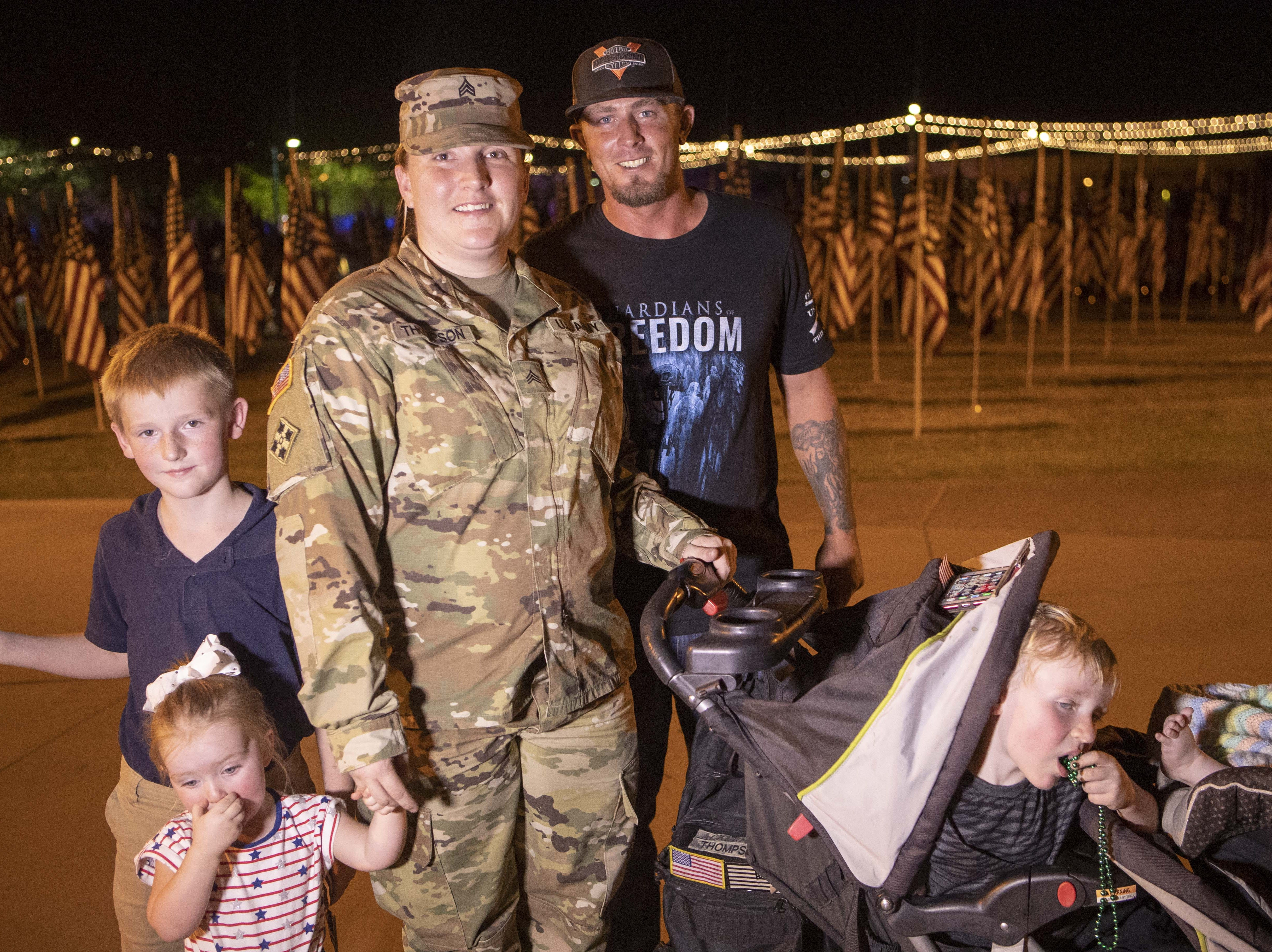 Army Sgt. Ashley Thompson and her boyfriend, Spc. Steven Ackerman, and Thompson's children participated in the ceremony at the Healing Field at Tempe Beach Park on Sept. 11, 2018.