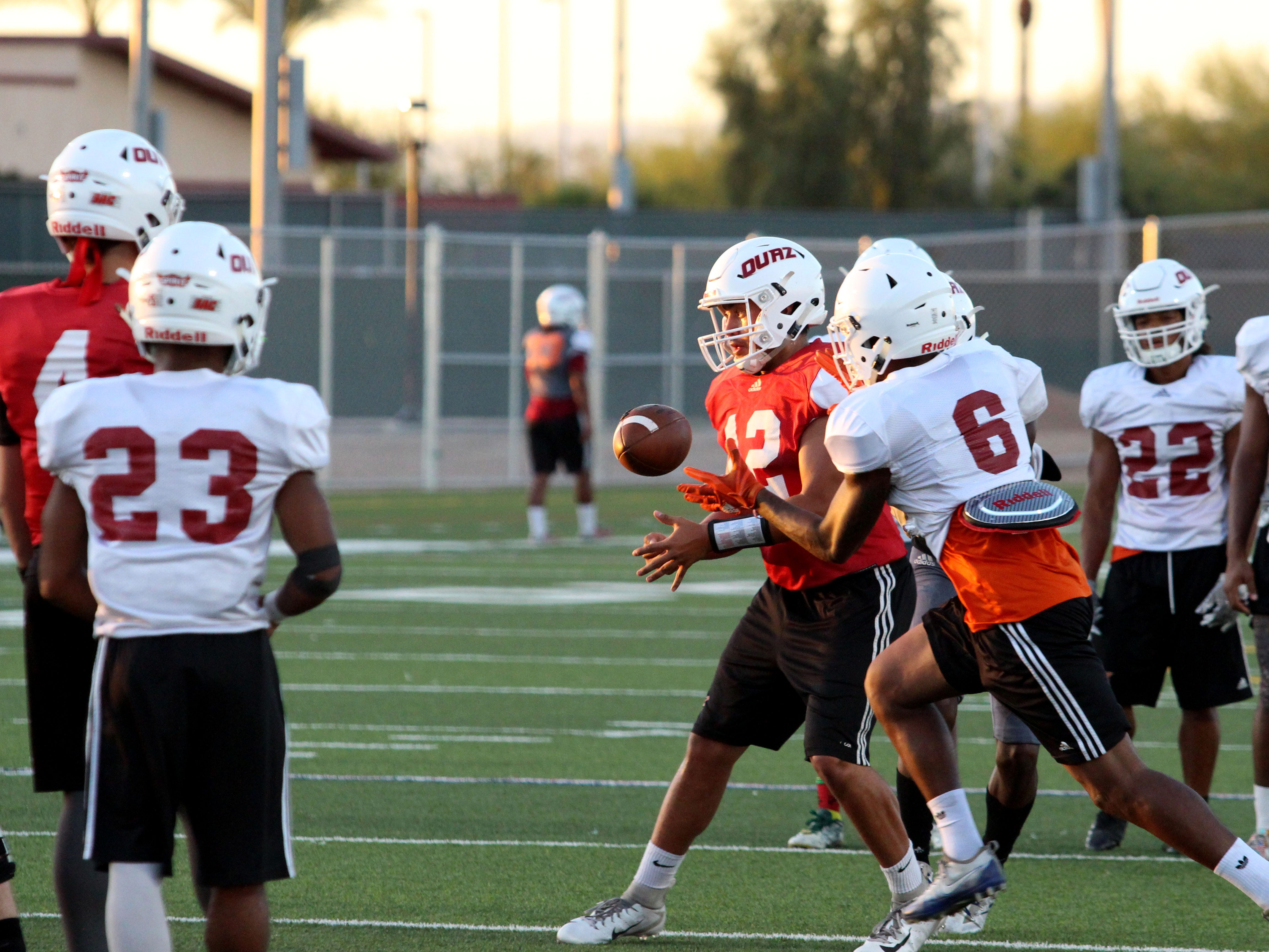 OUAZ players practice offense on Tuesday night in Surprise on Sept. 11, 2018.