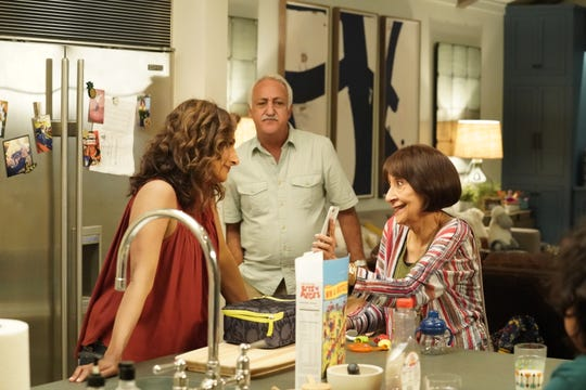 """In """"I Feel Bad,"""" Emet (Sarayu Blue, left) deals with her parents (Brian George and  Madhur Jaffrey)"""