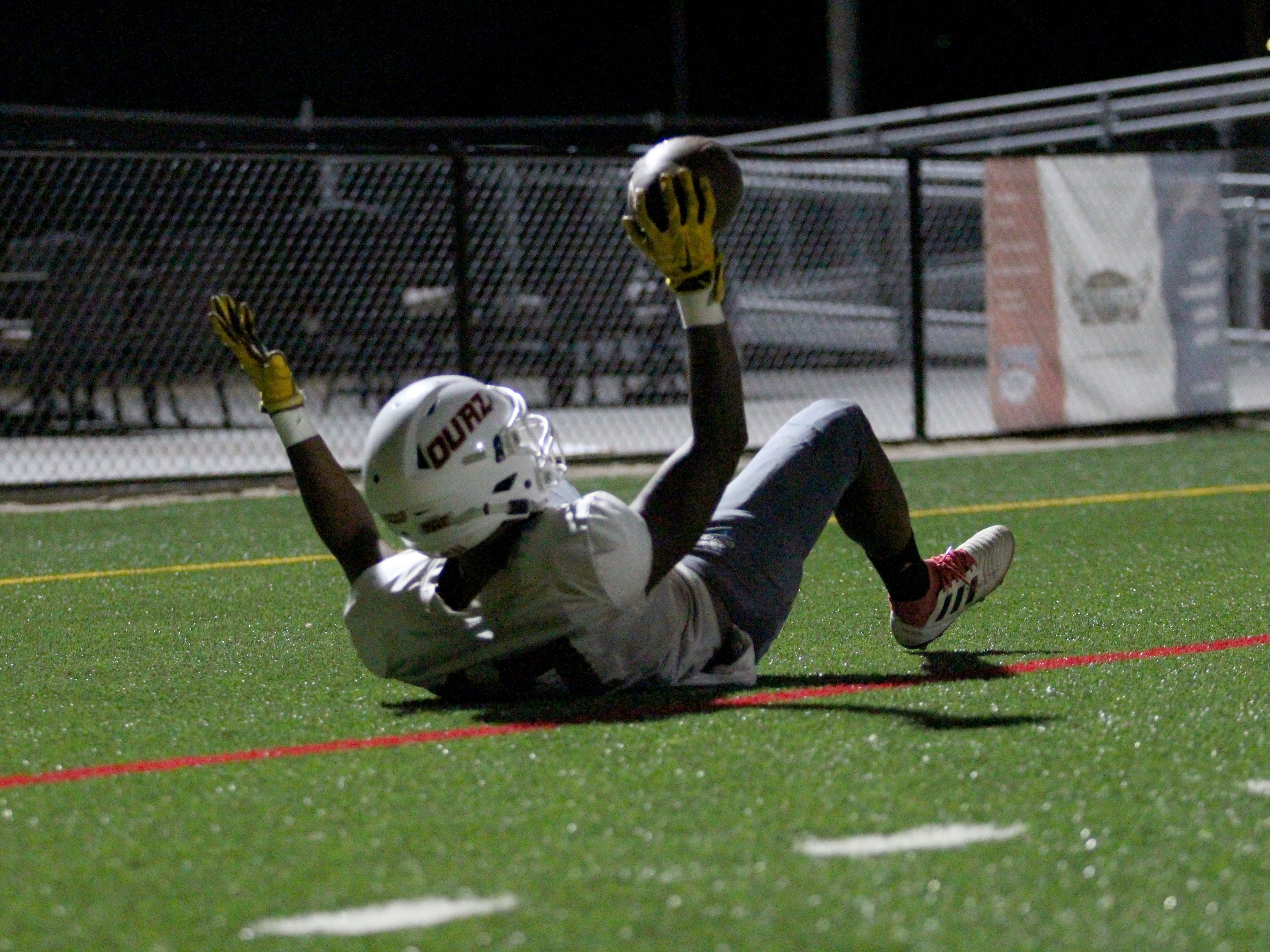 OUAZ's George Tribble Jr. celebrates a touchdown at practice on Tuesday night in Surprise on Sept. 11, 2018.