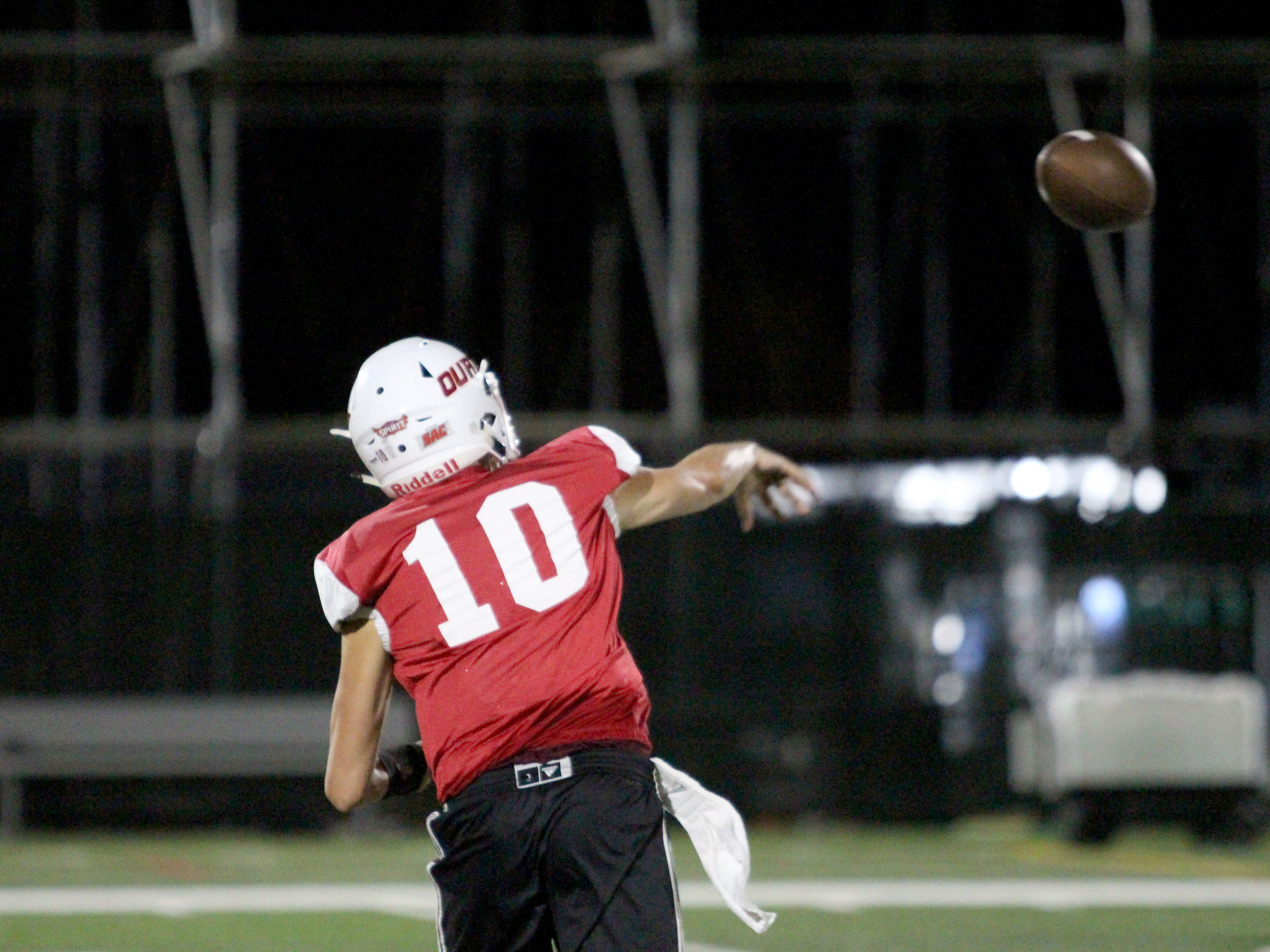 OUAZ's Austin McCullough throws a pass at practice on Tuesday night in Surprise on Sept. 11, 2018.