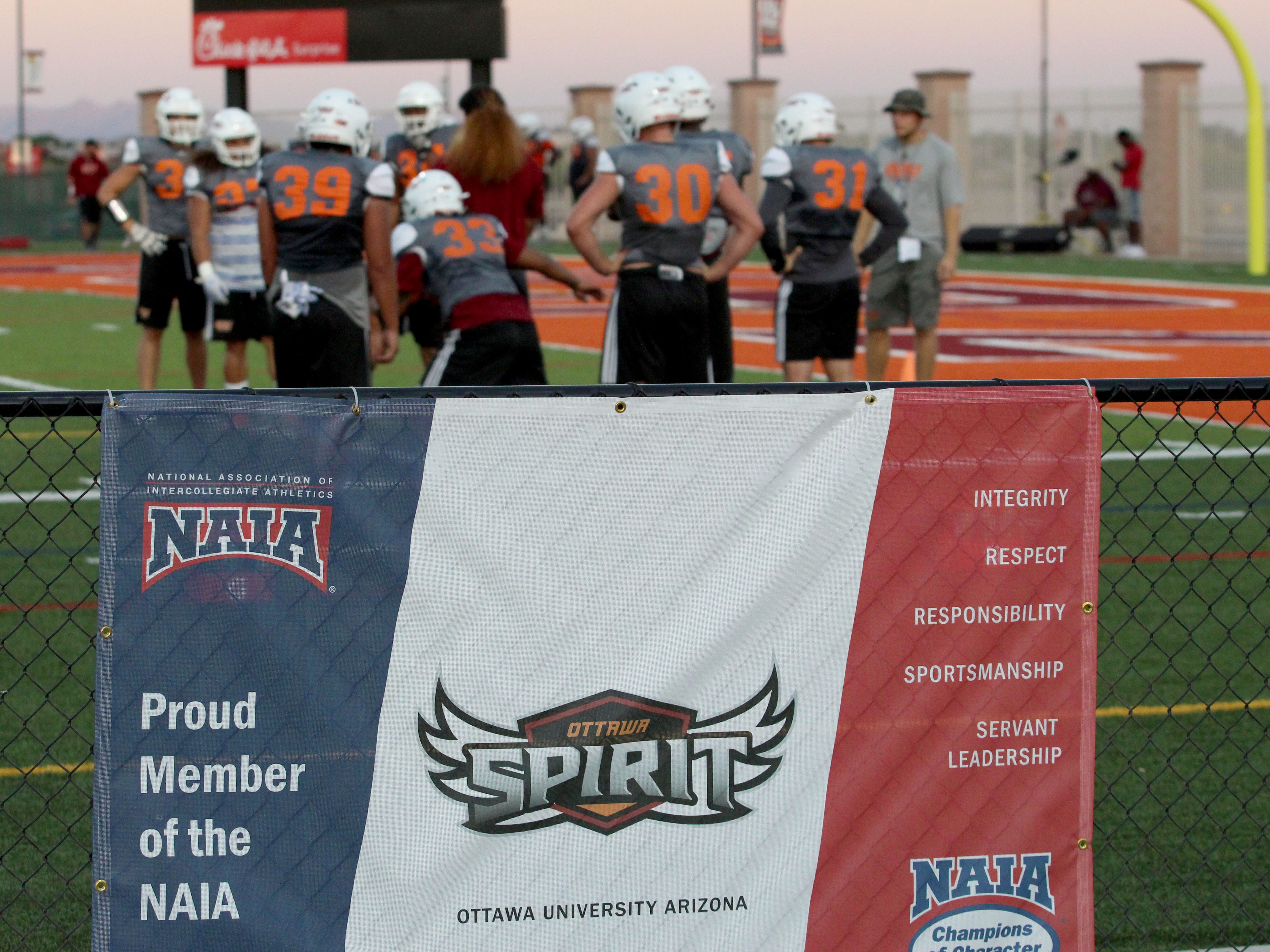 OUAZ hangs sign for inaugural season in NAIA on Tuesday night in Surprise on Sept. 11, 2018.