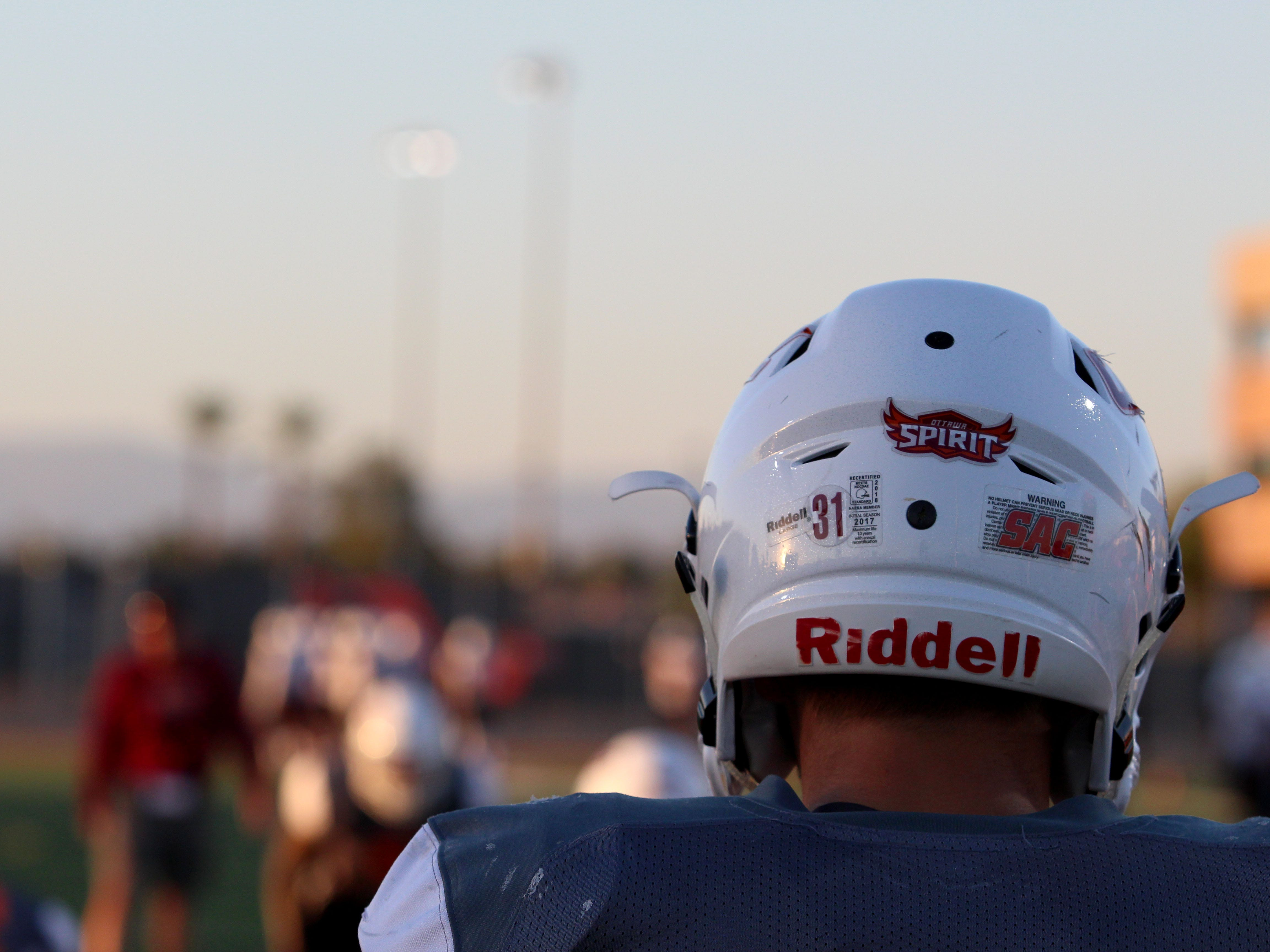 OUAZ players watch on in the end zone as a practice goes on Tuesday night in Surprise on Sept. 11, 2018.
