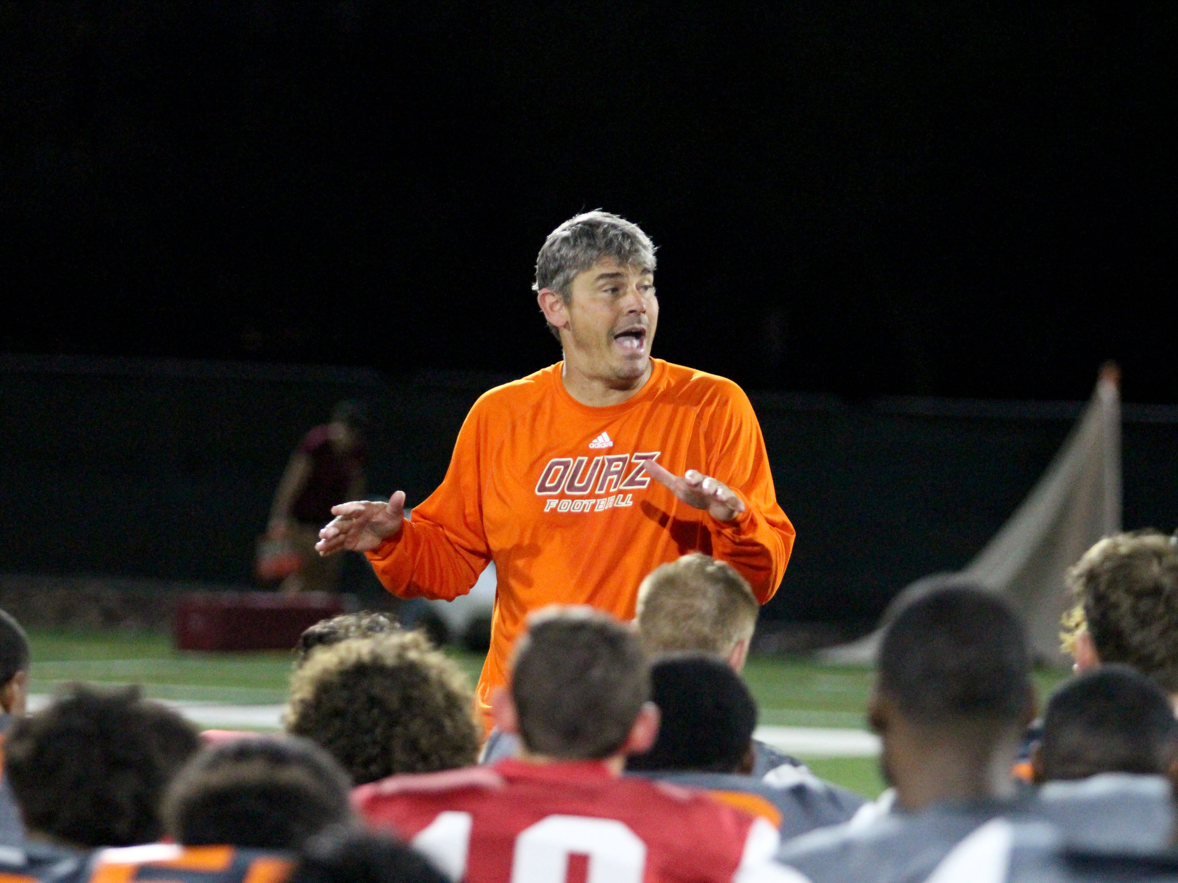 OUAZ coach Mike Nesbitt talks to his team after practice on Tuesday night in Surprise on Sept. 11, 2018.