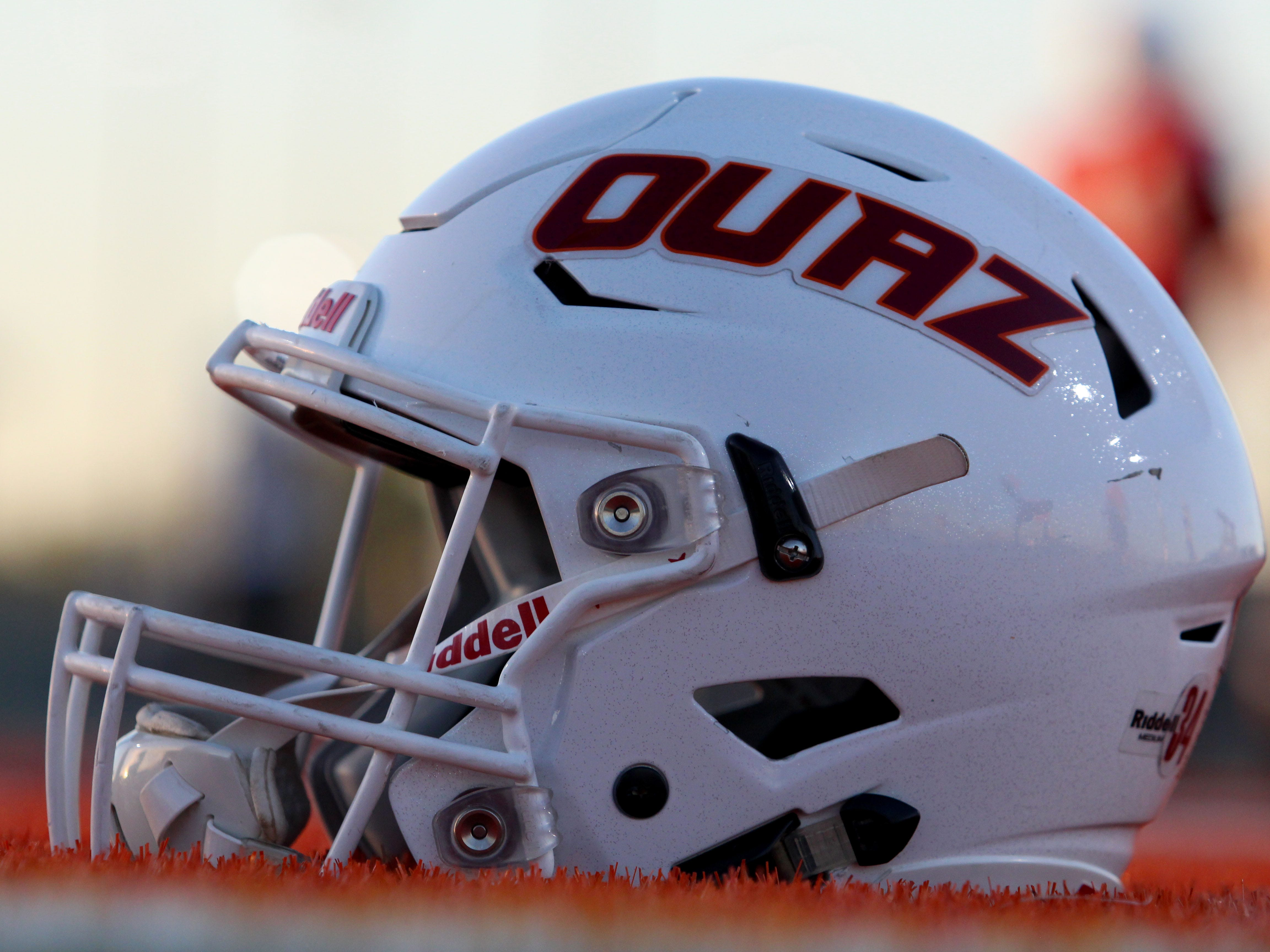 OUAZ helmet lays on the field on Tuesday night in Surprise on Sept. 11, 2018.