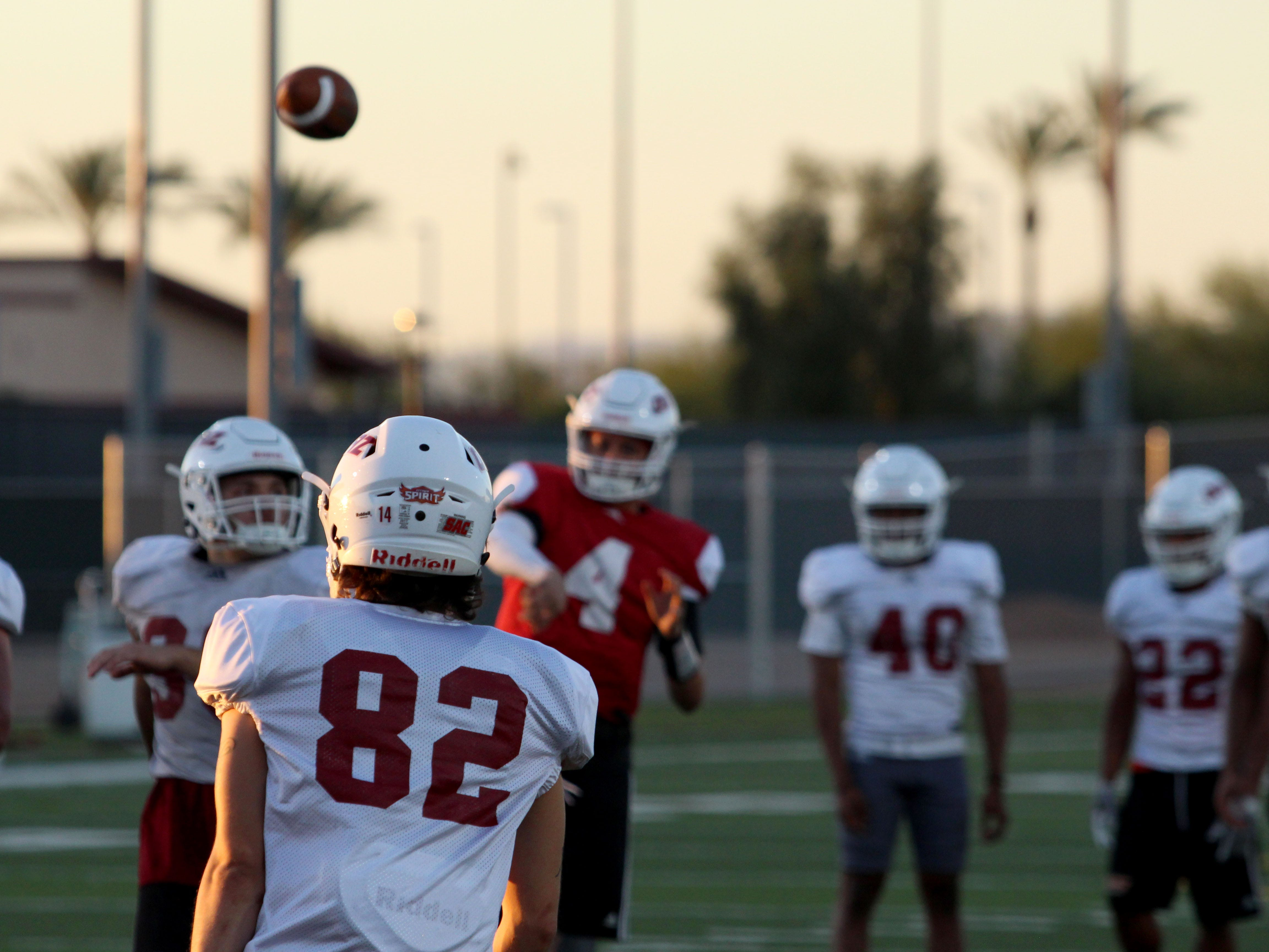 OUAZ's Jevan Hogan (4) throws it to a receiver on Tuesday night in Surprise on Sept. 11, 2018.