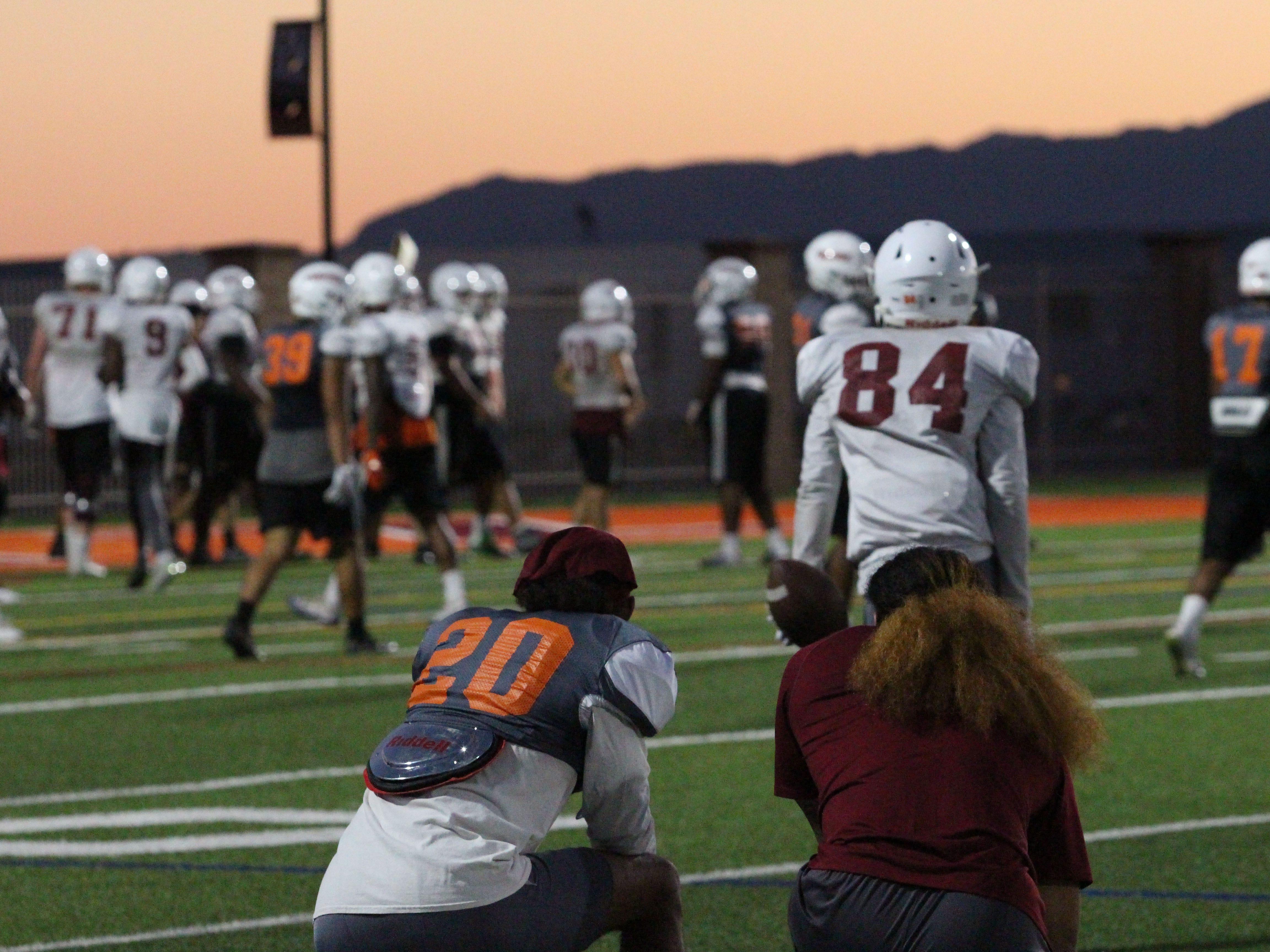 OUAZ's Joshua Vizcaya takes a knee and watches practice on the sideline on Tuesday night in Surprise on Sept. 11, 2018.