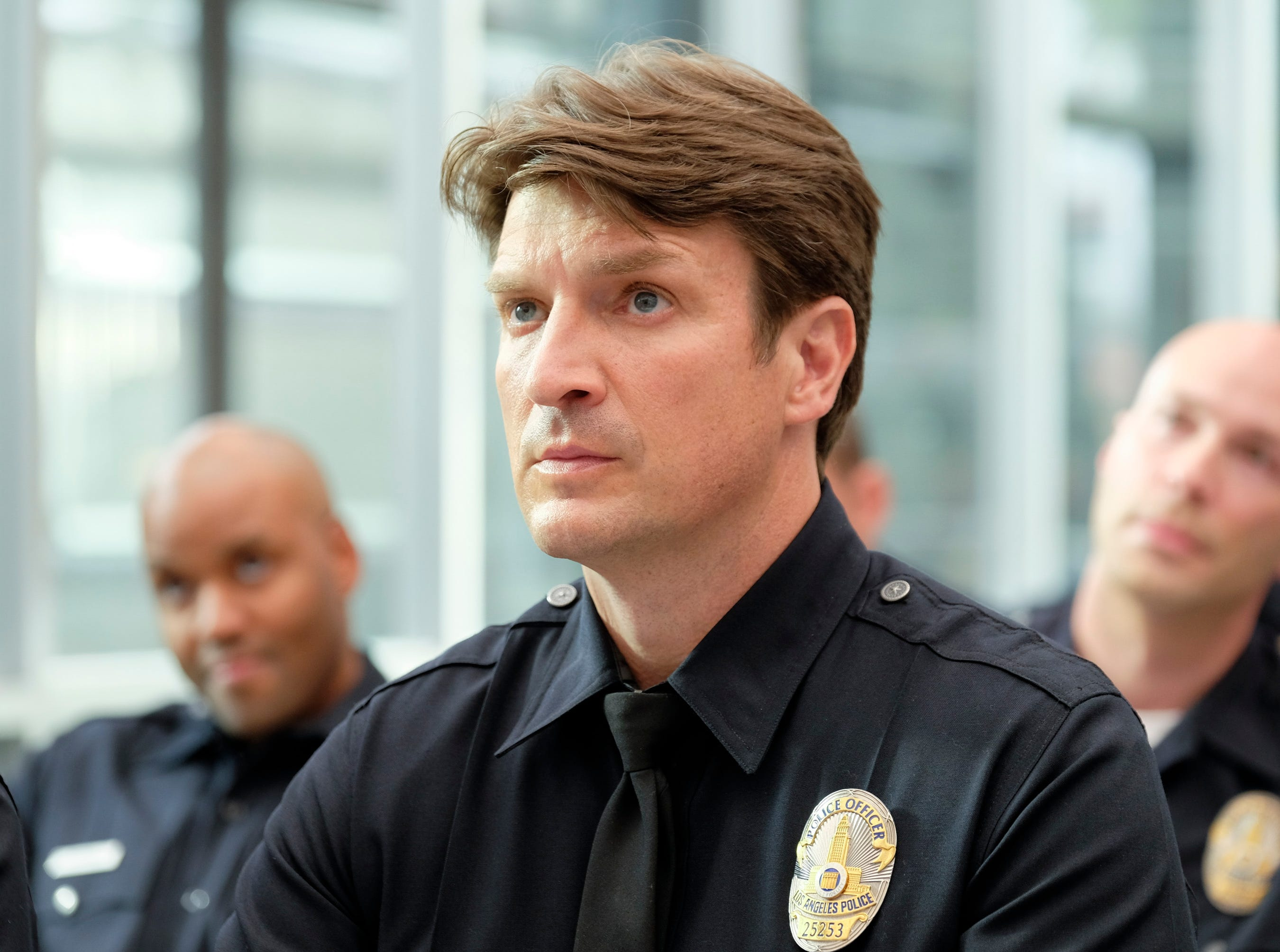 "After a life-changing incident, John (Nathan Fillion) decides to become a police officer in ""The Rookie."""