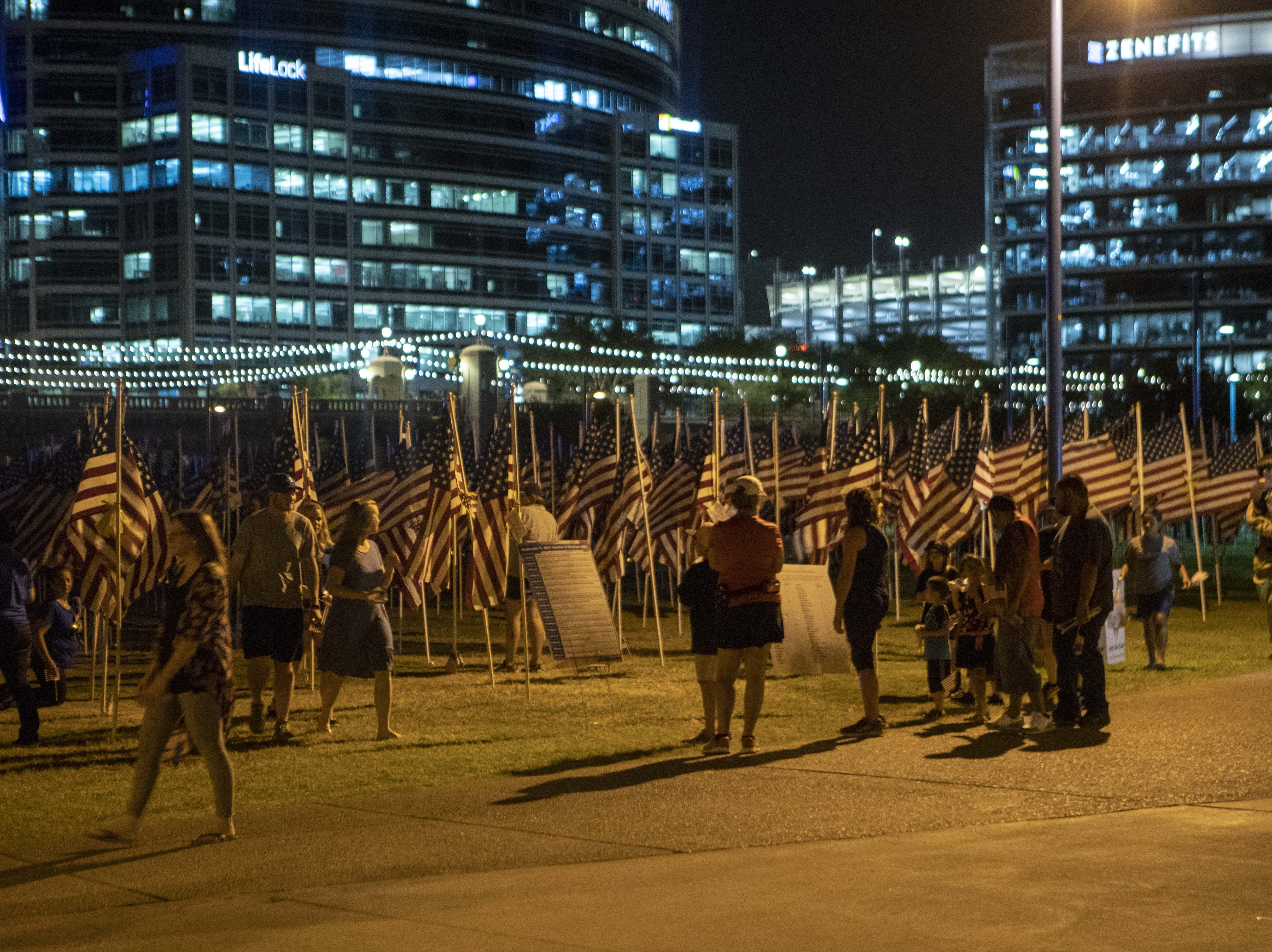 People came to participate during the ceremony at The Healing Field, at Tempe Beach Park on Sept. 11, 2018. This is an annual memorial to commemorate Sept. 11, 2001, terrorist attacks on U.S. soil.