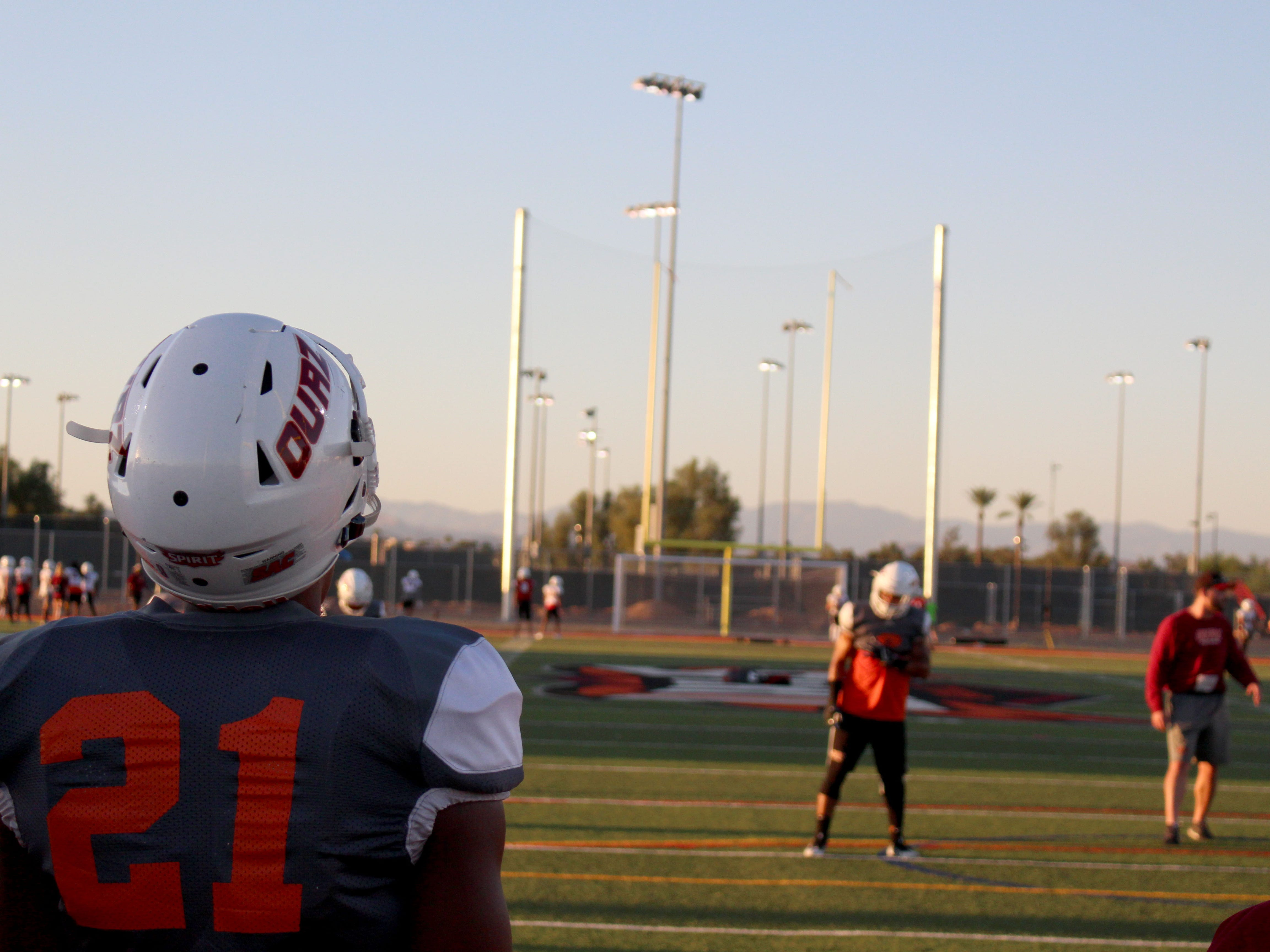 OUAZ's Kristopher Ewens watches the team practice from the end zone on Tuesday night in Surprise on Sept. 11, 2018.