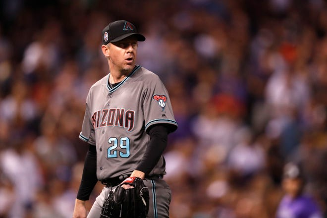 Arizona Diamondbacks relief pitcher Brad Ziegler heads to the dugout after retiring Colorado Rockies' DJ LeMahieu on a ground out with the bases loaded in the seventh inning of a baseball game Tuesday, Sept. 11, 2018, in Denver.