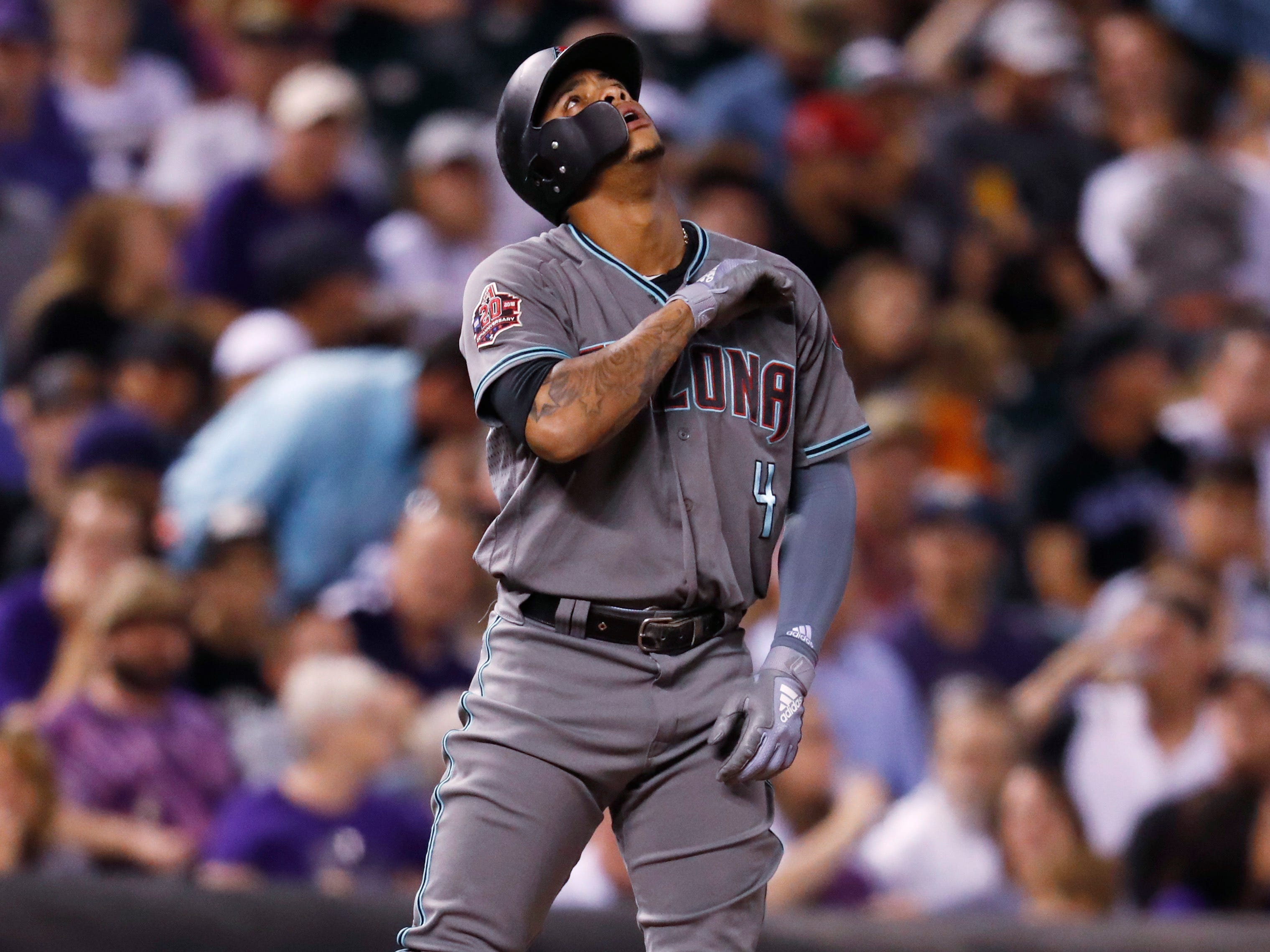 Arizona Diamondbacks' Ketel Marte gestures after hitting a triple to drive in two runs off Colorado Rockies starting pitcher Antonio Senzatela in the sixth inning of a baseball game Tuesday, Sept. 11, 2018, in Denver.