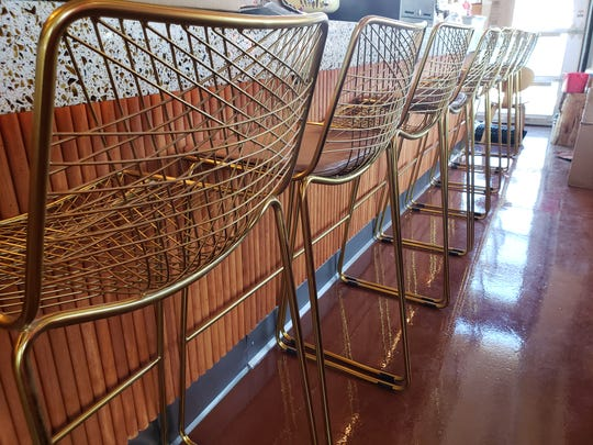 The gold bar stools at the main bar inside the new Hula's Modern Tiki.