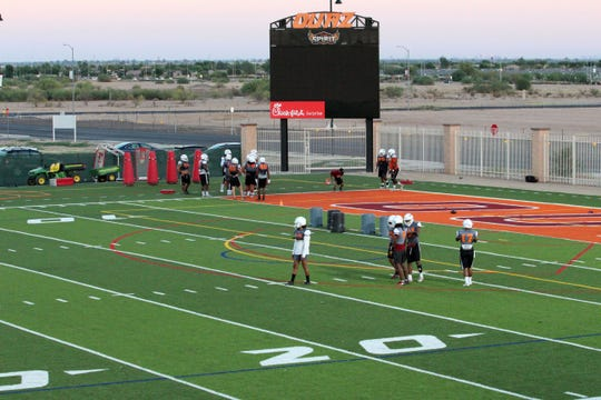 OUAZ players practice on new football field on Tuesday night in Surprise on Sept. 11, 2018.