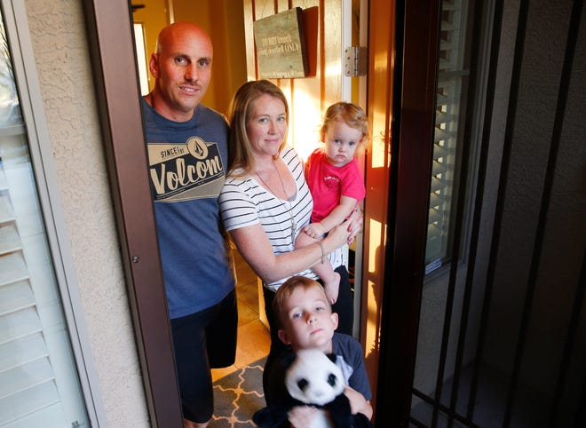 Mike and Heather Montgomery with their children, Chloe, 1, and Ethan, 6, inside their home in Anthem on Sept. 10, 2018. They purchased their home last year and it came with a home warranty. When their air conditioning went out, they couldn't get it repaired in a timely manner.