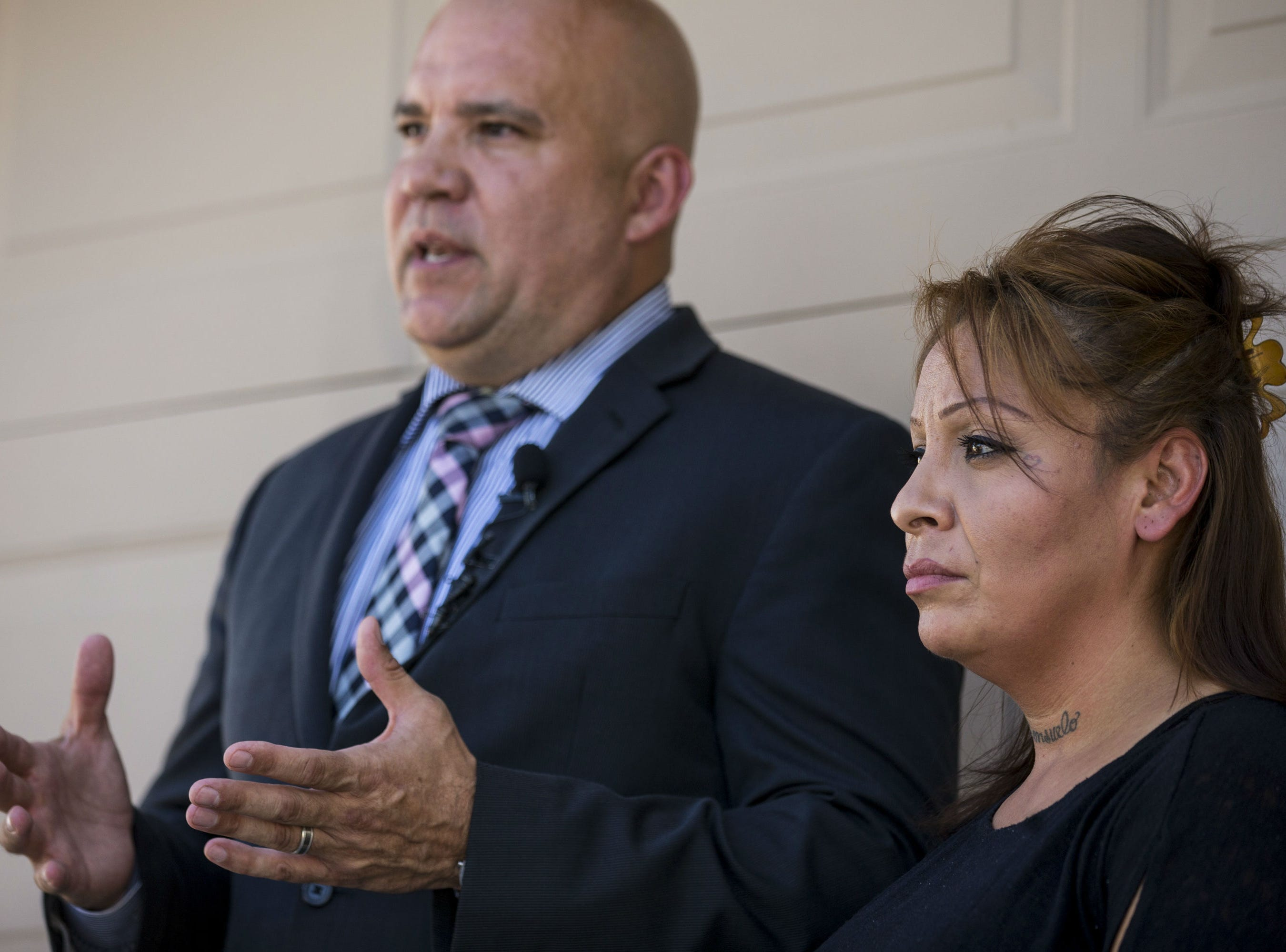 Renee Armenta listens as her attorney, Anthony Ramirez, speaks during a press conference on Sept. 11, 2018, in Avondale. A video taken by a bystander showed Armenta being dragged from her car and across asphalt by a Goodyear police officer.