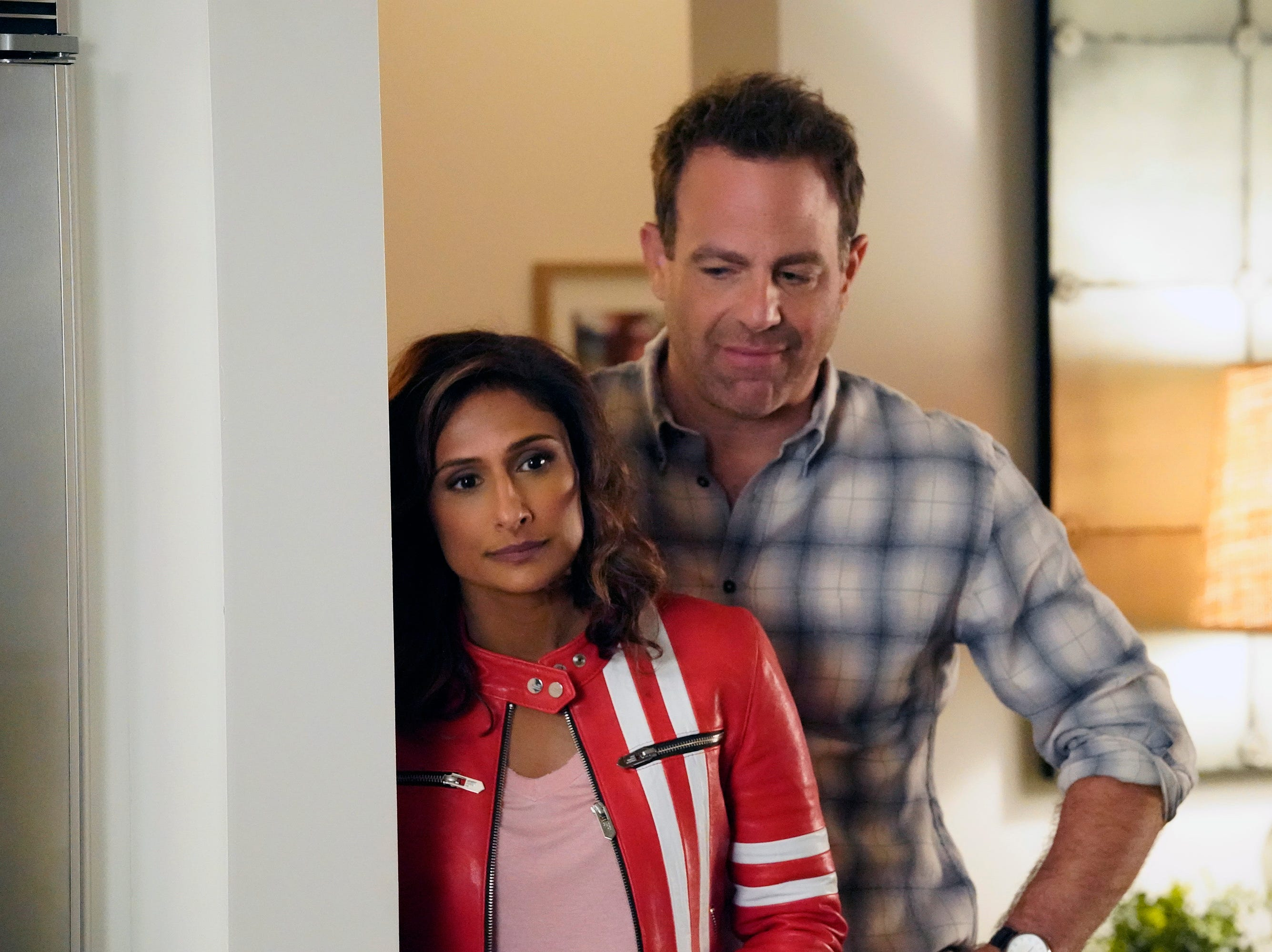 "Emeter (Sarayu Blue) and David (Paul Adelstein) are married in ""I Feel Bad."""