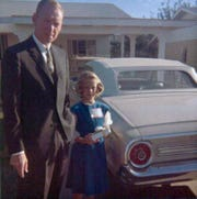 Virginia Prendergast with her dad next to the family's Ford Fairlane.
