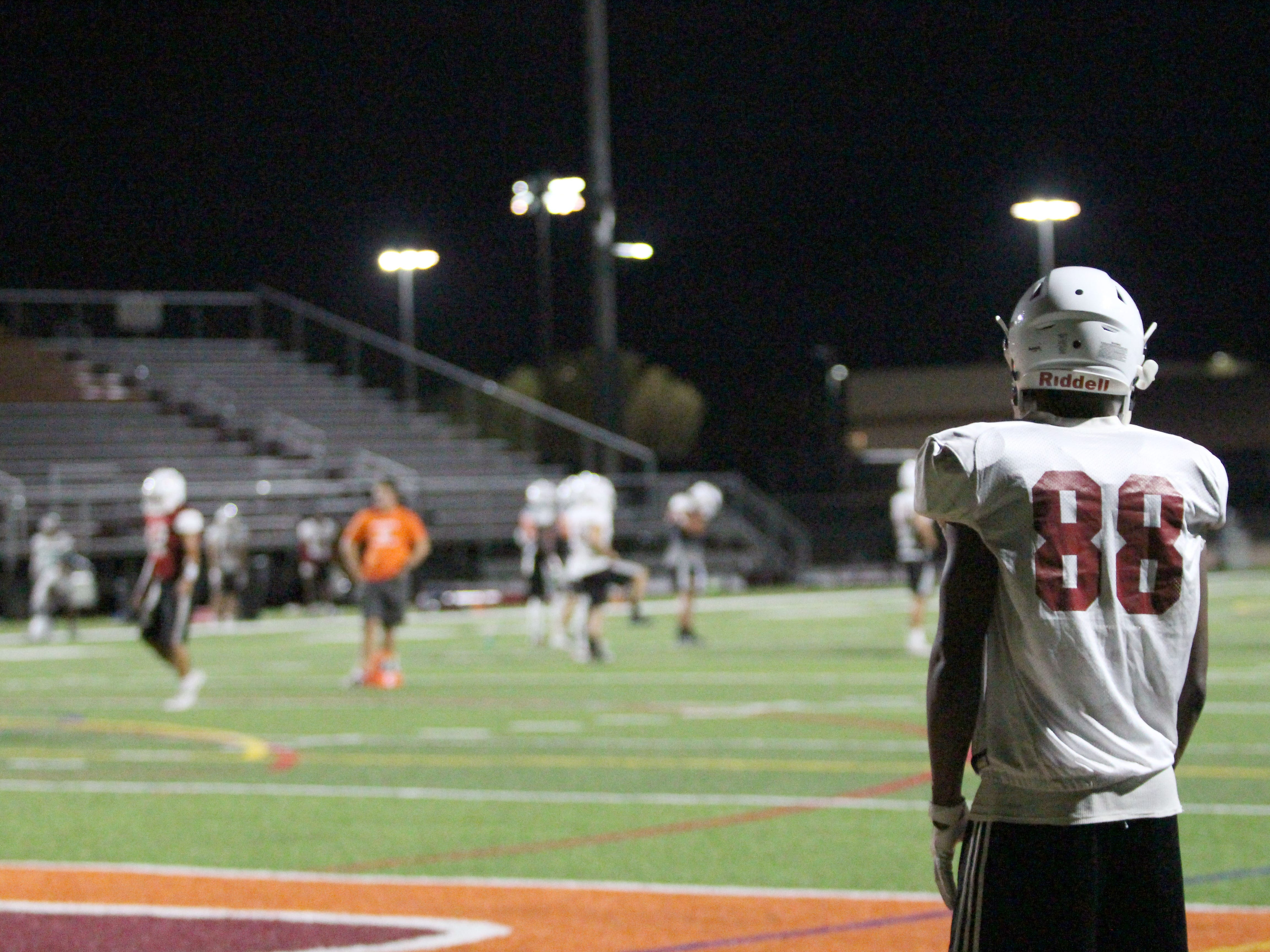 OUAZ's D'Montae Williams watches practice from the end zone on Tuesday night in Surprise on Sept. 11, 2018.