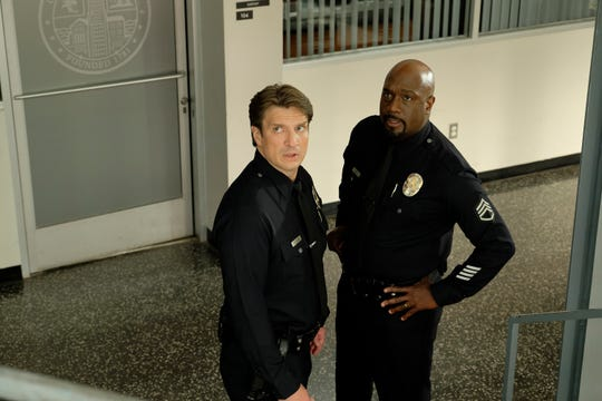 "Nathan Fillion (left) and Richard T. Jones star in ""The Rookie."""