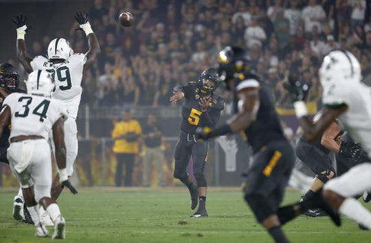 ASU quarterback Manny Wilkins throws a pass downfield to star receiver N'Keal Harry against Michigan State.