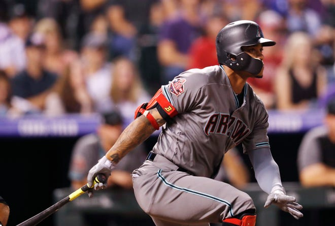 Arizona Diamondbacks' Ketel Marte follows the flight of his single to drive in two runs off Colorado Rockies relief pitcher Adam Ottavino in the eighth inning of a baseball game Tuesday, Sept. 11, 2018, in Denver.