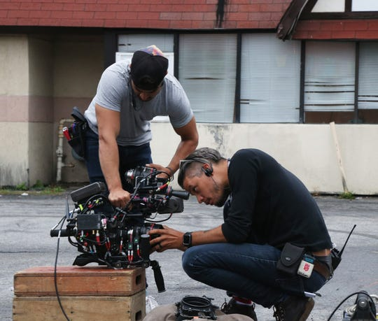 "A production crew from HBO's ""High Maintenance"" changes camera lenses Wednesday while shooting a scene outside Pete's Famous Restaurant in Poughkeepsie."
