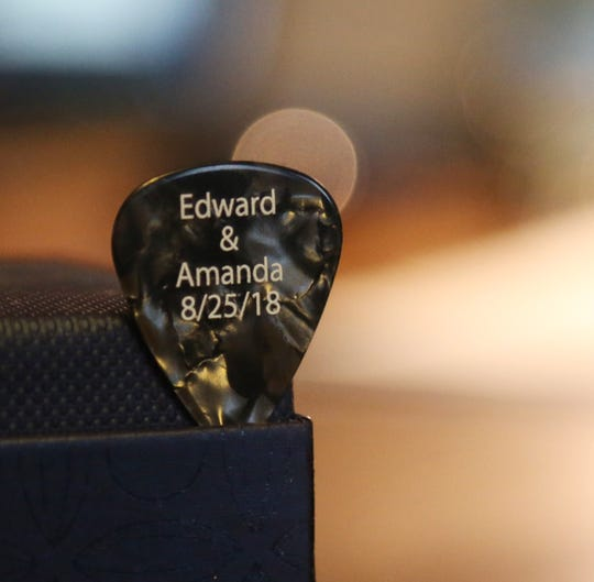 A guitar pick which was the favor for Amanda Schott-Just and Edward Just's wedding at their home in the Village of Wappingers Falls on September 11, 2018. The couple met on Facebook and were married in August 2018.