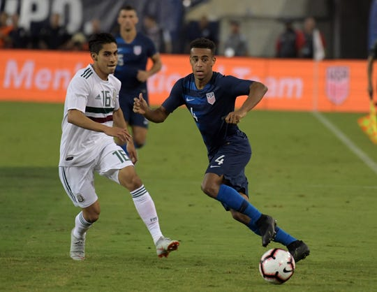 United States midfielder Tyler Adams, right, is defended by Mexico midfielder Erick Aguirre in the second half during an international friendly soccer match at Nissan Stadium in Nashville on Tuesday.